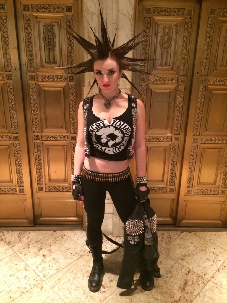 Erin is wearing studs and spikes, leather cuff, bullet belt, and AYP DIY customized tee.  She is also wearing Lip Service Bondage Leggings, and her own vest & gloves.